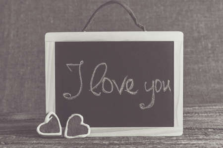 about you: I love you handwritten on a black chalkboard with cookies.