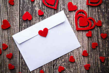 White envelope with red hearts for valentines day.