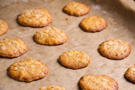 baking tray: Homemade oat cookies on baking tray for breakfast.