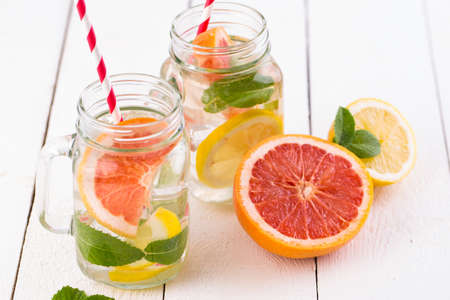 glass jar: Summer detox drink with fresh fruits in glass jar.