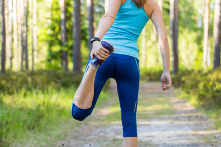 get ready: Young woman runner doing exercise and get ready to run with sports smartwatch.