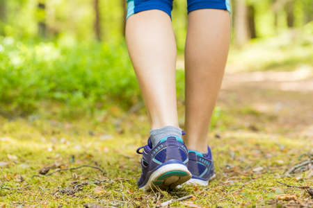 forest trail: Woman running legs in forest trail.
