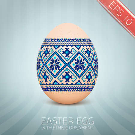The Easter egg with an Ukrainian folk pattern ornament. Isolated realistic egg. Vettoriali