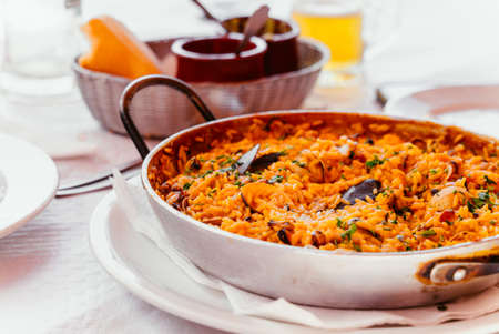 Spanish Seafood Paella with mussels, shrimps etc. in a steel paella pan. Canary islands cousine in a small family restaurant