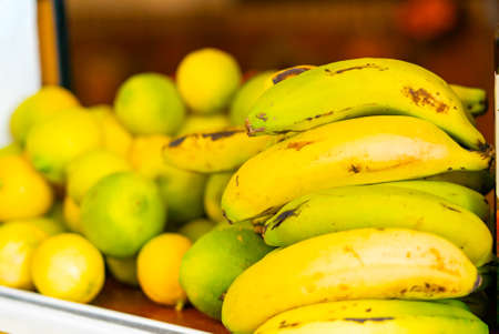 Fruits on a shop counter in Puerto de la Cruz. Bananas and lemons.