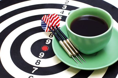 darts and coffee, in bright cups on a white background photo