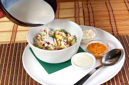 okroshka: Soup an okroshka with kefir in a white plate on a table Stock Photo