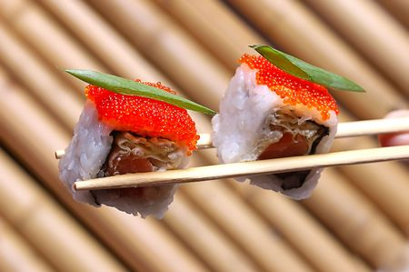 sushi with red caviar on the Chinese sticks