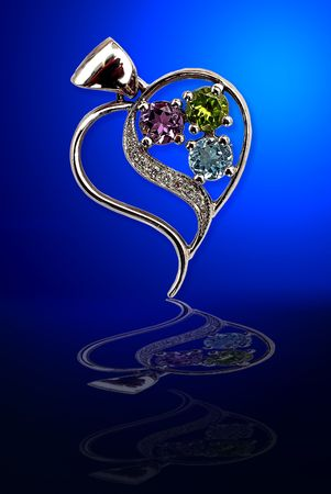 jewels from white gold with brilliants on dark blue glass photo