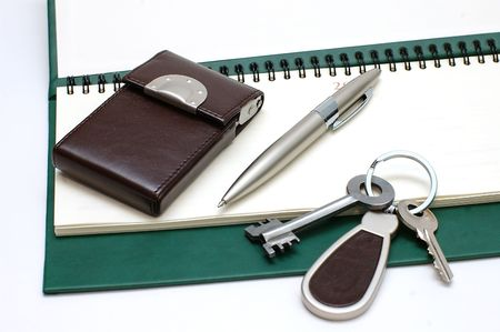 Diary, the handle and keys on a white background photo