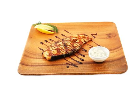 Baked fish with a lemon on a wooden dish on a white background Stock Photo - 6625442