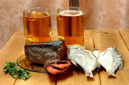 Beer and  fish on  table photo