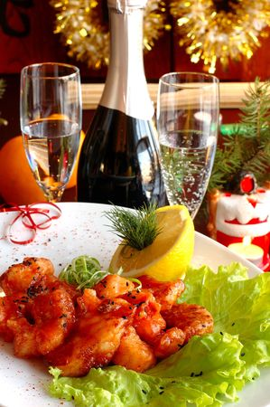 prepared fish on a celebratory, christmas table with a champagne