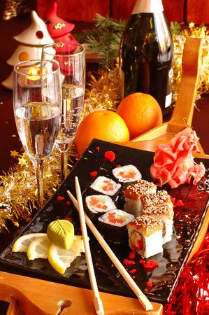 sushi on a celebratory, christmas table with a champagne