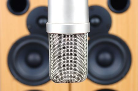 Microphone in sound studio on a background of acoustic systems