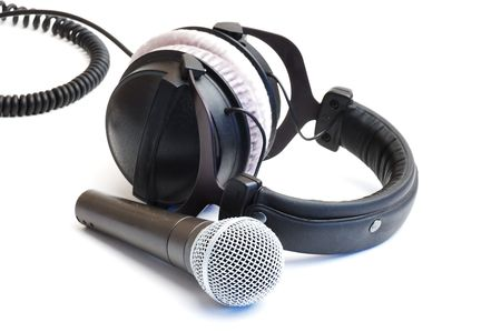 qualitative: Modern scenic microphone and professional ear-phones on a white background