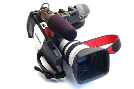 Professional video camera close up on a white background