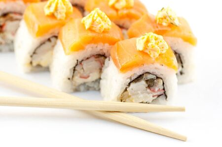 sushi with sticks on a white background close up photo