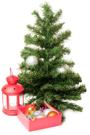 Christmas fur-tree on a white background with spheres and gifts Stock Photo