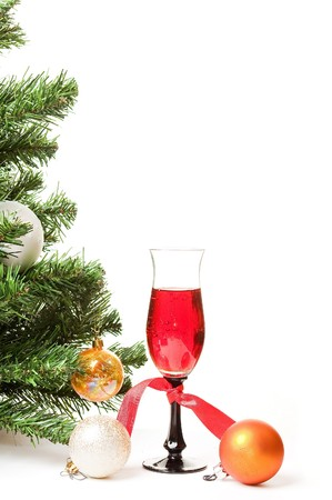 Christmas fur-tree with a glass of wine and an ornament on a white background for a card Stock Photo - 8214137