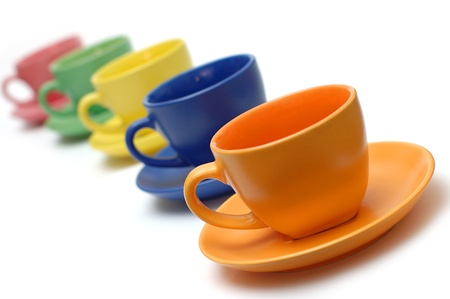 Colour tea pairs on a white background of a cup and a saucer Stock Photo - 8256084