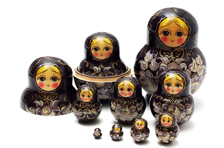 Set of traditional, wooden, national dolls on a white background Stock Photo - 8791861