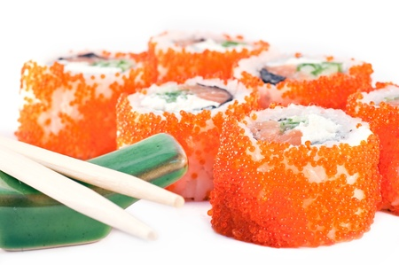 sushi with red caviar and the Chinese sticks close up.