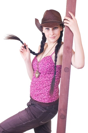 lovely young girl the cowboy with a ladder on a white background close up photo