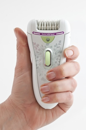 Modern electric epilator close up on a white background