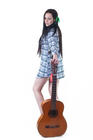 The girl with a guitar with a shirt and long black hair on a white background Stock Photo - 9204730