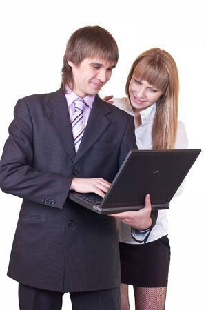 Man and woman in business suits working on laptop computer. Shot in studio over white. photo