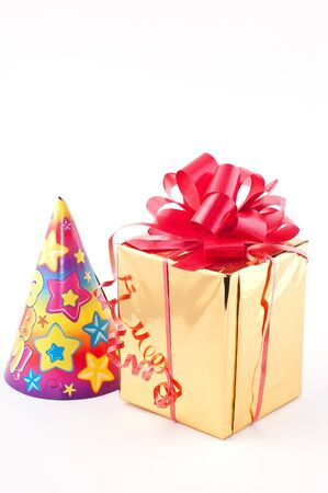 sweepstake: Prize a gift with a red tape in a gold wrapper close up.