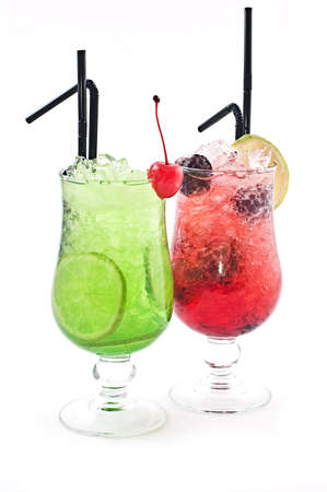 Red and green cocktails in tubules standing nearby on a white background photo