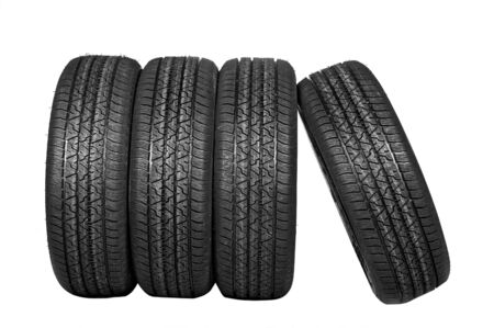 Four all-weather tyres on a white background with a protector photo