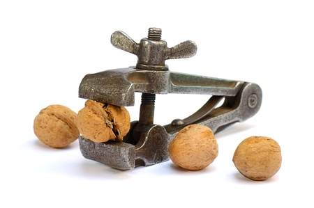 clamped: The cracked nut clamped in an iron vice on a white background Stock Photo
