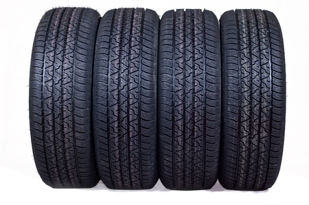 tyre tread: The complete set of new tyres for the car on a white background