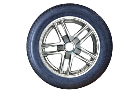 Car tire with rim on a white background photo