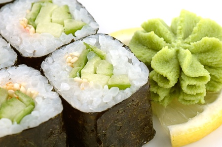 Sushi rolls, in a row, isolated on white with reflection.