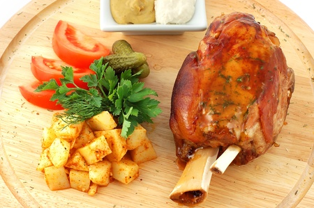 Pork with vegetables on a wooden support with sauce and mustard close up Stock Photo - 11534734