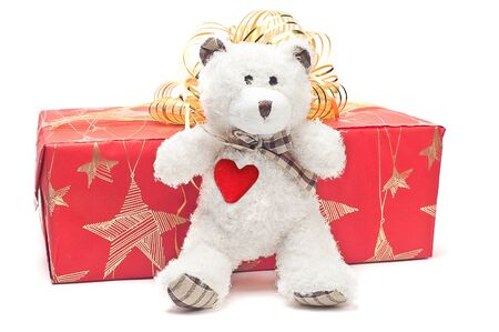 bear, gifts and prizes in bright packings on a white background photo
