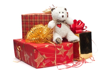 Bear, gifts and prizes in bright packings on a white background Stock Photo - 11986634