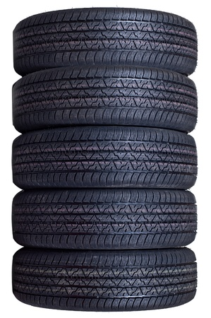 The complete set of new automobile tyres isolated on a white background photo