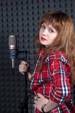 The girl in recording studio with a microphone close up Stock Photo - 13351060