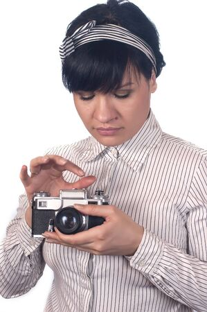 Retro style, the girl the photographer with the chamber on a support photo