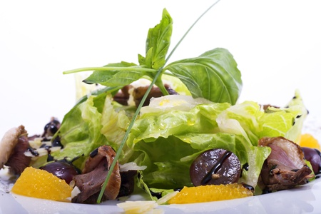 Salad with mushrooms and tangerines on a white background close up Stock Photo
