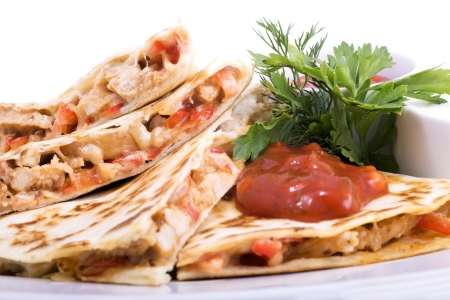 Quesadillas with Cajun Chicken Cheese Tomato Salsa and corn salad photo