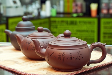 Clay teapots close up with small depth of sharpness photo