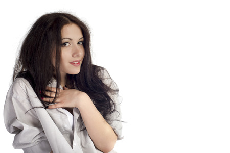 voluptuous women: portrait of a young brunette woman on a white background in the early morning