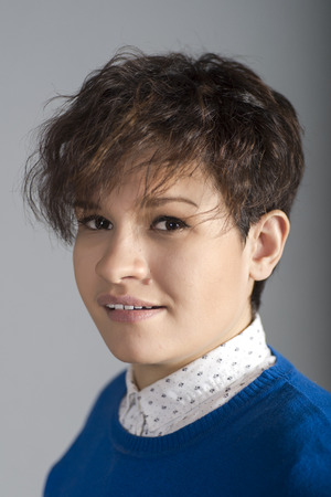 portrait of a girl with short hair close-up on a gray background with shallow depth of field Stock Photo