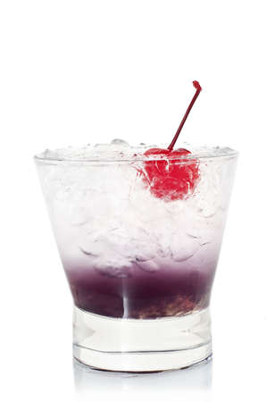 cocktail with ice and a cherry in a short glass on a white background close-up for a menu